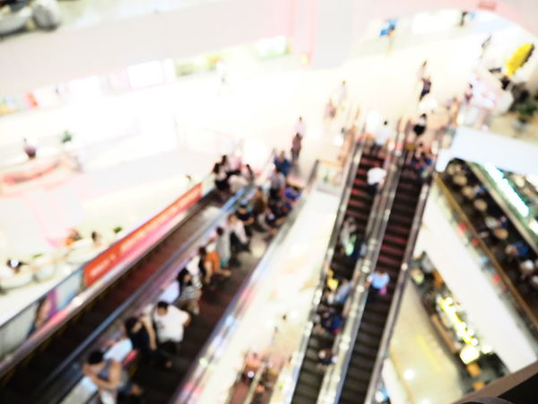 Blurred interior of shopping mall. The modern building concept. Group Of People Large Group Of People Transportation City Crowd Architecture High Angle View Real People Mode Of Transportation Shopping City Life Travel Motion Shopping Mall Commuter Crowded Blurred Motion Walking Retail  Consumerism Outdoors