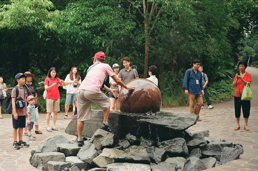 what ever you do, don't touch the spinning orb. oops ... too late. 35mm Film Analogue Photography ASIA Everybodystreet Film Film Is Not Dead Film Photography Filmisnotdead Outdoors Park Singapore Street Street Photography The Tourist Water Fountain