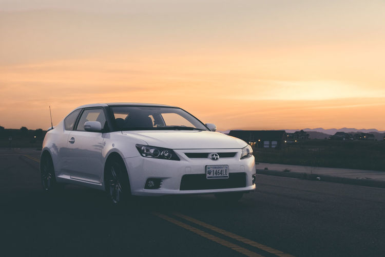Sunsets and fast cars. Sky Photography Moody Orange Clouds Dramatic Clouds And Sky Outdoors Toyota Car Sports Car Sunset Car Sun Sky Cloud - Sky Romantic Sky Dramatic Sky Moody Sky Auto Racing
