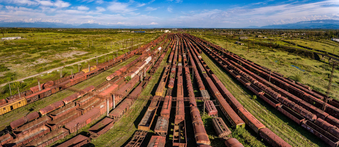 Abandoned rusted trains from former Soviet Union in country of Georgia Georgia Train Tracks Abondoned Beauty In Nature Cloud - Sky Day Environment Field High Angle View Horizon Land Landscape Nature No People Outdoors Rail Transportation Railroad Track Rusted Scenics - Nature Sky Track Tranquil Scene Tranquility Transportation Ussr