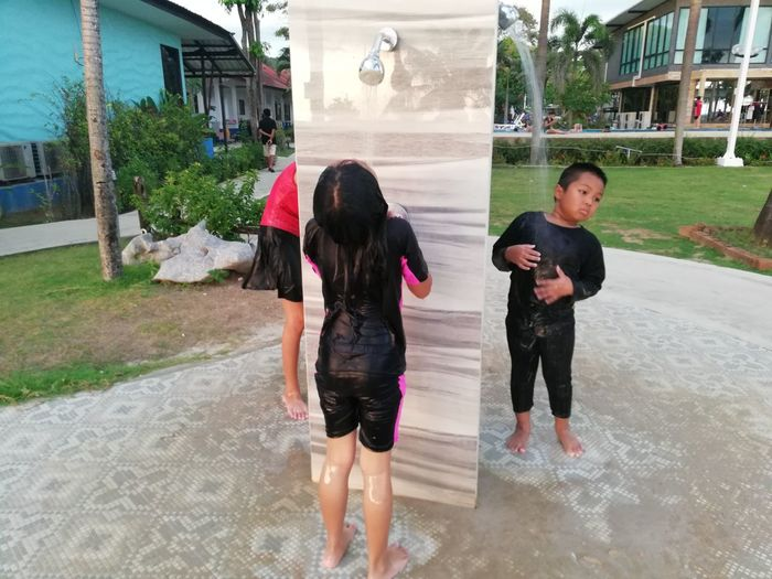 Children enjoy on summer trip 2019,หาดเจ้าหลาว Achi2019 Architecture Building Exterior Real People Built Structure Full Length Leisure Activity Childhood Lifestyles Child Water Women People Wet Group Of People Casual Clothing Day Girls Men Togetherness Outdoors Rain