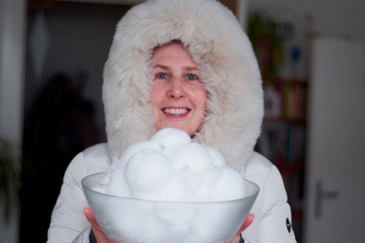 Portrait of woman holding hat