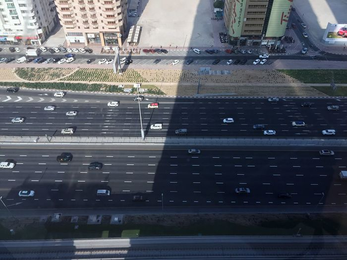 Taking Photos Car Dubai City Shaikh Zayed Road Warwickhotel Sunlight And Shadow Land Vehicle Aerial View Cityscape Building Exterior Built Structure Day