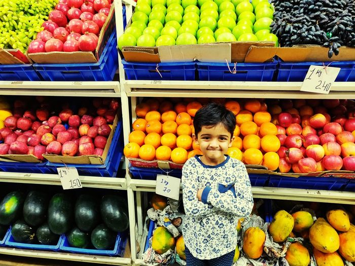 Happy fruits and healthy smile ! Sunday Morning Sunday India Food Nature Oranges Apples Kid Smiles Healthylife Healthy Eating Healthy Food Fruits And Vegetables Fruits Photography Fruits Market Fruits Collection Supermarket Portrait Childhood Smiling Fruit Market Child Choice Retail  Variation Farmer's Market Watermelon Shelves