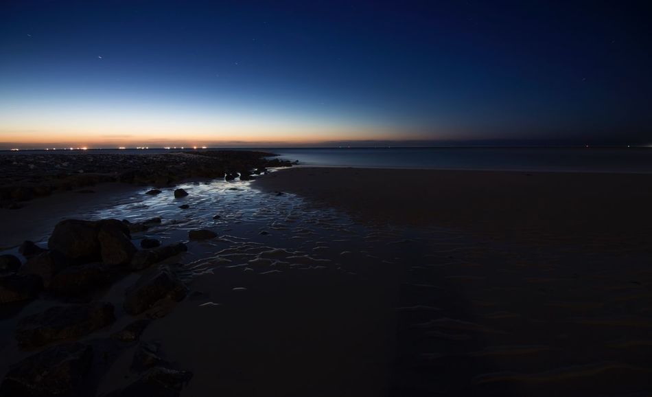 Wangerooge Night Sea Beach Water Nature Beauty In Nature Sand Sunset Scenics Tranquility Tranquil Scene Horizon Over Water Sky Reflection Outdoors Clear Sky No People Moon Astronomy Blue Hour Stones Mudflat The Great Outdoors - 2018 EyeEm Awards