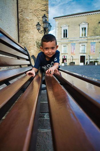 Portrait of boy against building