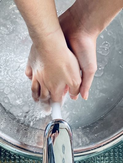 Close-up of person washing hands