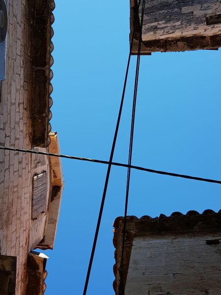 Old Town Architecture Blue Building Exterior Built Structure Cable Clear Sky Connecting Houses Connectingpeople Day Electricity Wires Lookingup Low Angle View No People Outdoors Sky