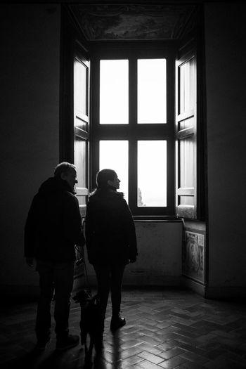 People Standing Against Window