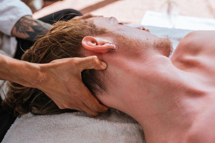 Close-up of shirtless man lying down