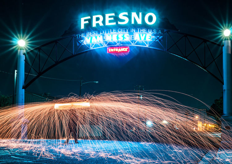 Blue City Conquer_ca Electric Light Gameoftones Glowing Illuminated Information Information Sign Lighting Equipment Neon Neon Lights Neon Sign Night No People Outdoors Road Sign Sky Sparks Steel Wool Text Urban