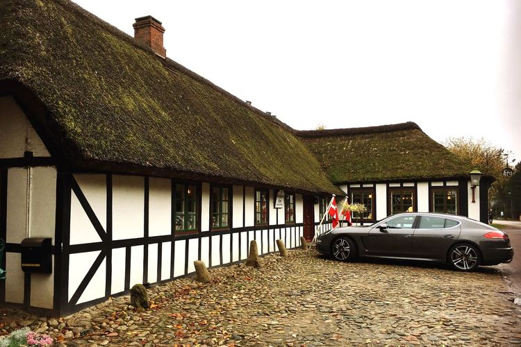 Denmark 🇩🇰🇩🇰🇩🇰 Danish Inn Porche Old House On The Road Old Historical Building Architecture Built Structure Building Exterior House Transportation Beauty In Nature Nature Fine Art Fine Art Photography Residential Structure Clear Sky Mode Of Transport Parked Stationary Day Rural Scene No People Place For Resistance People World War 2