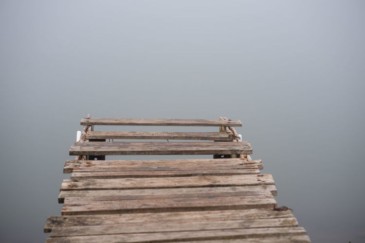 Old deck No People Wood - Material Built Structure Architecture Nature Water Stack Copy Space Day Pier Fog Sky Outdoors Sea Low Angle View Wood Religion Balance