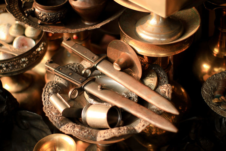 High angle view of antique objects for sale