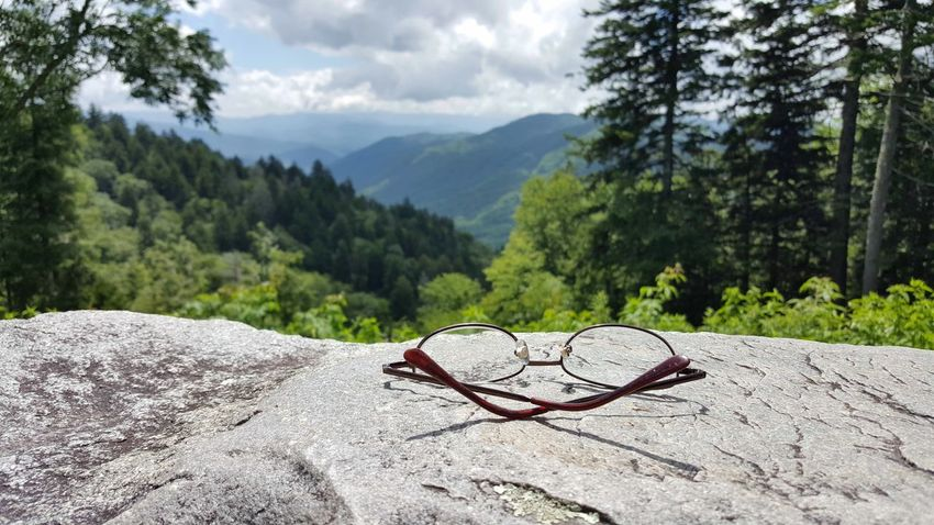 Mountain Range Mountain View Found Object Glasses Close Up Optical Stone Surface Mountains In Background Landscape Setting Aside Taking A Moment Nature Active Lifestyle  Trees Lush Green Mountains Great Smoky Mountains  Non Urban Scene Day Summer Sunlight