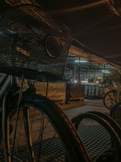 Illuminated bicycle parked at night
