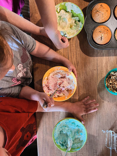 Directly above shot of kids preparing food on table