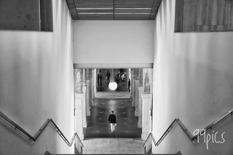 Pasaba por allí. Built Structure Architecture Indoors  One Person Streetphoto_bw Shadow And Light From My Point Of View Silouette And Shadows Black And White Light - Natural Phenomenon Blackandwhite Photography Shadows & Lights Blackandwhite Only Men Simetrybuildings The Secret Spaces Madrid Spain