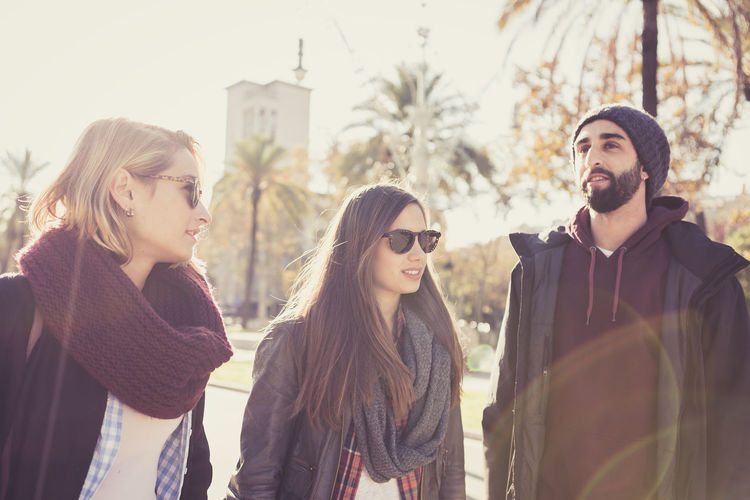 Three friends walking around the city. Backlight Barcelona Friends Happy Winter Casual Clothing City Day Eyeglasses  Fashion Fashion Model Friendship Leisure Activity Lifestyles Outdoors People Real People Smiling Standing Togetherness Vintage Young Adult Young Men Young Women