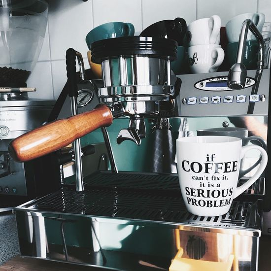 NoProblems Coffee Drink Cafe Food And Drink Text Indoors  Coffee Cup Machinery Coffee Maker Coffee - Drink Espresso Maker Indoors  No People Metal Still Life Coffee Shop Kitchen Container Business Food And Drink Industry Appliance