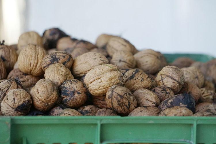 Close-Up Of Walnuts In Crate