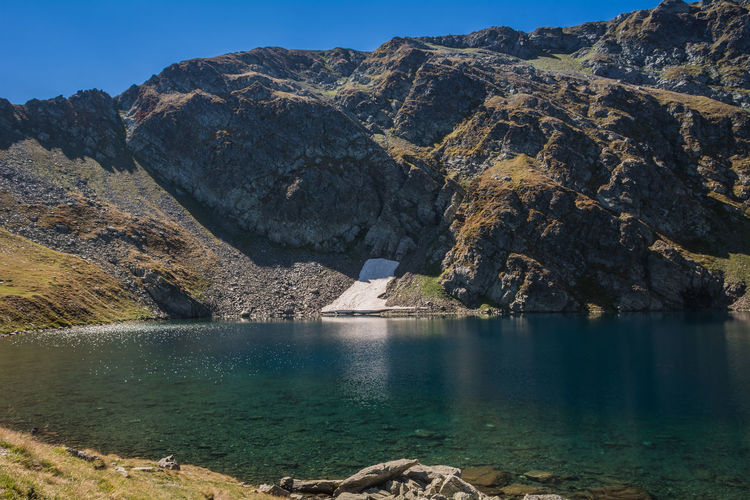 Seven Rila Lakes, Bulgaria The Eye Окото (Okoto) 2,440 m (8,010 ft) 6.8 ha (17 acres) 37.5 m (123 ft) Named after its oval shape. Deepest cirque lake in Bulgaria Water Mountain Scenics - Nature Beauty In Nature Rock Tranquil Scene Tranquility Day Nature Rock - Object Solid No People Non-urban Scene Mountain Range Lake Remote Rock Formation Outdoors Sunlight Formation Snow Nature Nature_collection Nature Photography Beauty In Nature