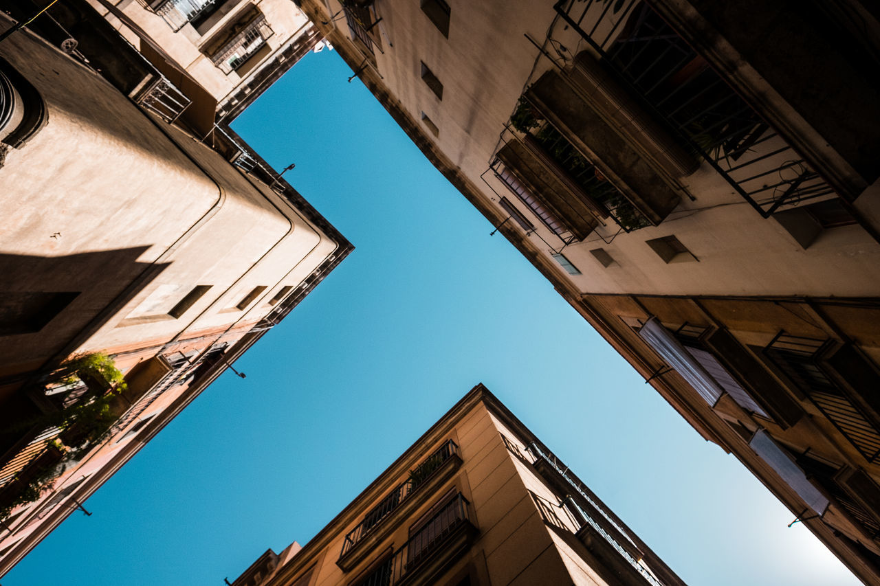 low angle view, architecture, building exterior, built structure, outdoors, day, no people, window, clear sky, sky