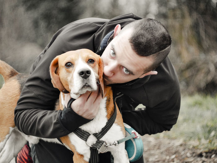 Canine Dog Pets Domestic Domestic Animals One Animal Mammal Real People Vertebrate Portrait One Person Focus On Foreground Looking At Camera Leisure Activity Day Pet Owner Outdoors Warm Clothing Beagle