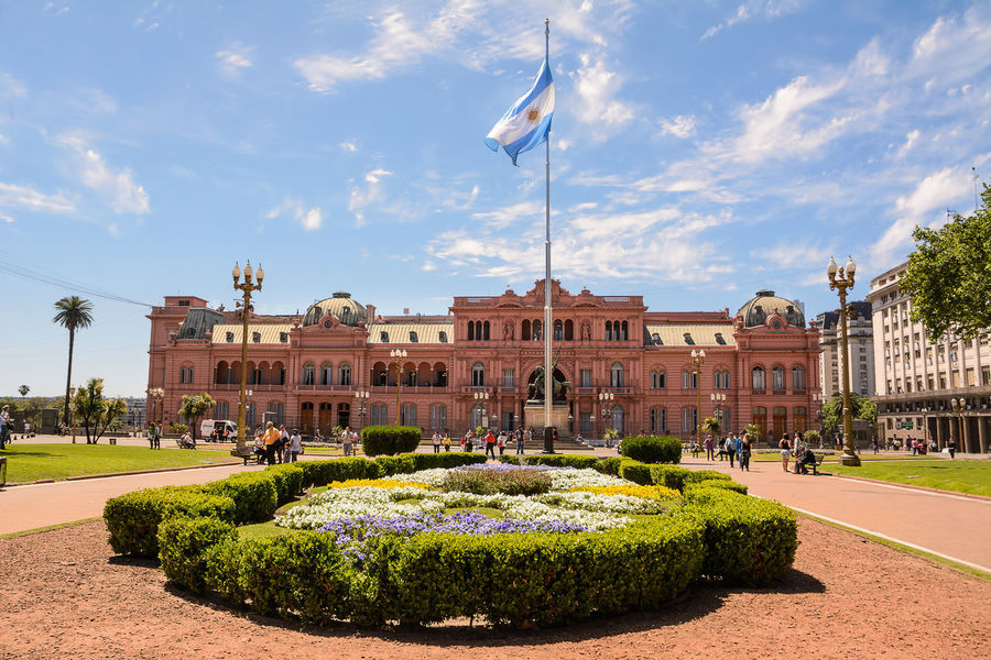 Buenos Aires, Argentina - Otober 30, 2016: Casa Rosada in Plaza de Mayo in Buenos aires with tourist in a sunny day. America Argentina Argentine Buenos Aires Building Capital Casa Rosada City Ciudad Autónoma De Buenos Aires Flag Formal Garden Government Government House Landmark Palace People Pink Plaza De Mayo President Presidential Sightseeing Square Street Tourist