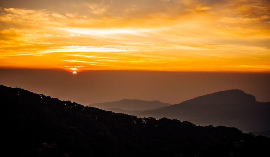 beautiful sunset Travel Wanderlust Aroundtheworld Cloud - Sky Environment Idyllic Landscape Majestic Mountain Mountain Peak Mountain Range Nature No People Non-urban Scene Orange Color Outdoors Remote Scenics - Nature Silhouette Sky Sunset Tranquil Scene Tranquility Warm Colors Wild