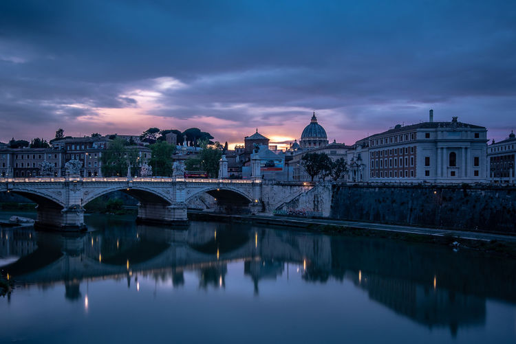 Riverbank Church Italia Rome Italy Roma Rome Outdoors Dusk Sundown Sunset Long Exposure Copyspace Copy Space No People Travel Destinations Nature Bridge - Man Made Structure Waterfront Reflection Bridge River Connection Cloud - Sky Sky Water Building Exterior Architecture Built Structure Street Light