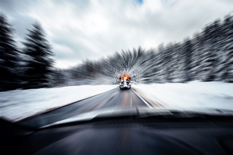 Motion Transportation Mode Of Transportation on the move Blurred Motion Cloud - Sky Nature Car Motor Vehicle Travel Land Vehicle Sky Day Tree Speed Road Outdoors The Way Forward Direction Road Trip Winter Wintertime Street Harz Harzmountains