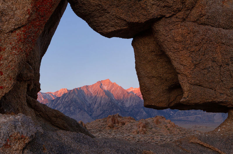 Sunrise on the sierra nevadas viewed through boot arch