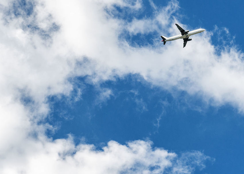 Airplane over cloudy sky background Aeroplane Sky And Clouds Air Vehicle Airliner Airplane Arrival Blue Charter Plane Cloud - Sky Commercial Airplane Day Departure Flying In The Sky Journey Mode Of Transport Nature Outdoors Sky Sunny Day Transportation