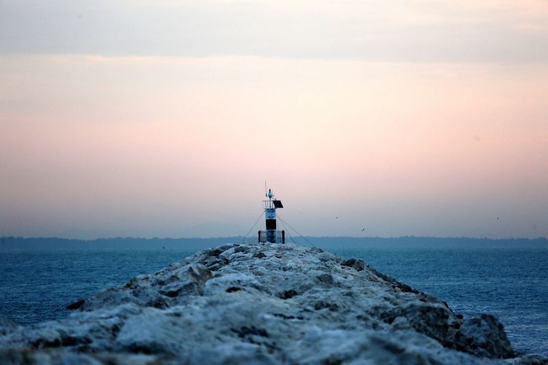Lighthouse Sea Sunset Horizon Over Water Nature Scenics Beauty In Nature Water Sky Lighthouse Outdoors One Person Architecture Day People EyeEmNewHere