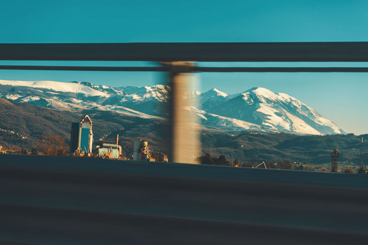 Scenic view of snowcapped mountains seen through window