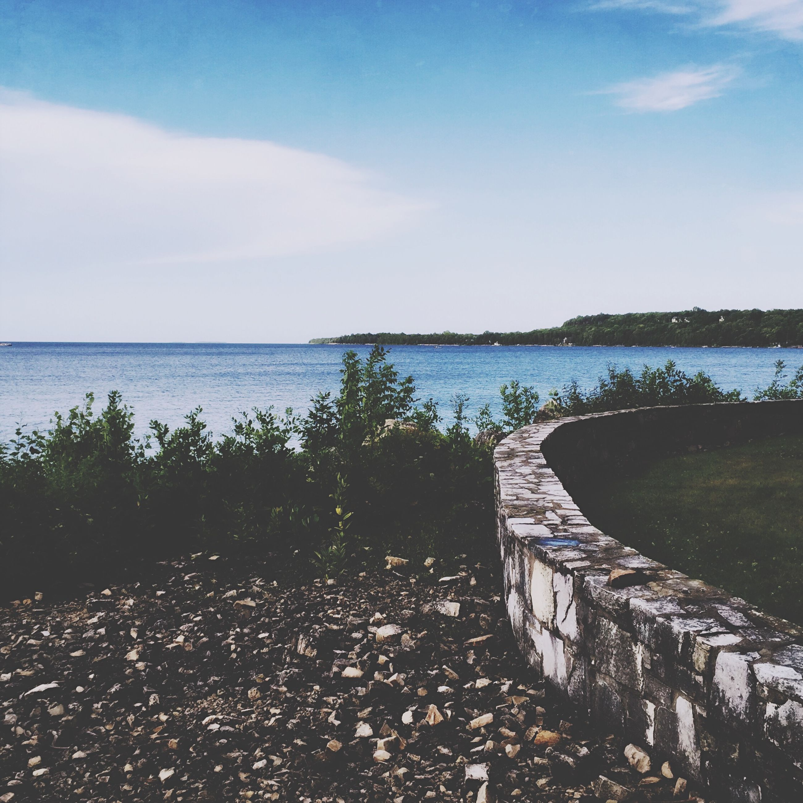 water, sky, tranquil scene, sea, tranquility, scenics, beauty in nature, horizon over water, nature, blue, cloud - sky, cloud, idyllic, rock - object, day, calm, lake, no people, outdoors, reflection