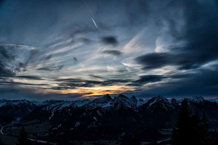 Sunset on the mountain Cloud - Sky Sky Scenics - Nature Beauty In Nature Mountain Tranquil Scene Tranquility Snow Environment Winter Mountain Range Cold Temperature Non-urban Scene No People Nature Landscape Dramatic Sky Tree Sunset Snowcapped Mountain Outdoors Mountain Peak Alps Tyrol Austria Winter