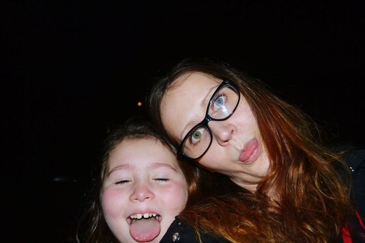 Portrait of woman with daughter at night