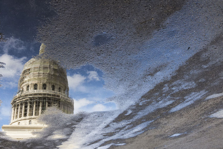 Reflection of church on puddle