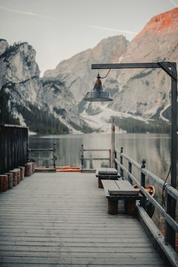 Pier In Lake Against Snowcapped Mountains