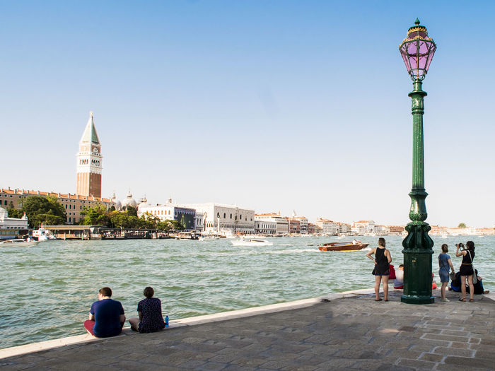 Architecture Blue Boat Capital Cities  Casual Clothing City Clear Sky Famous Place Lifestyles People Punta Della Dogana Rear View San Marco Square Tourist Tourists Travel Destinations Vacations Venezia Venice, Italy Water
