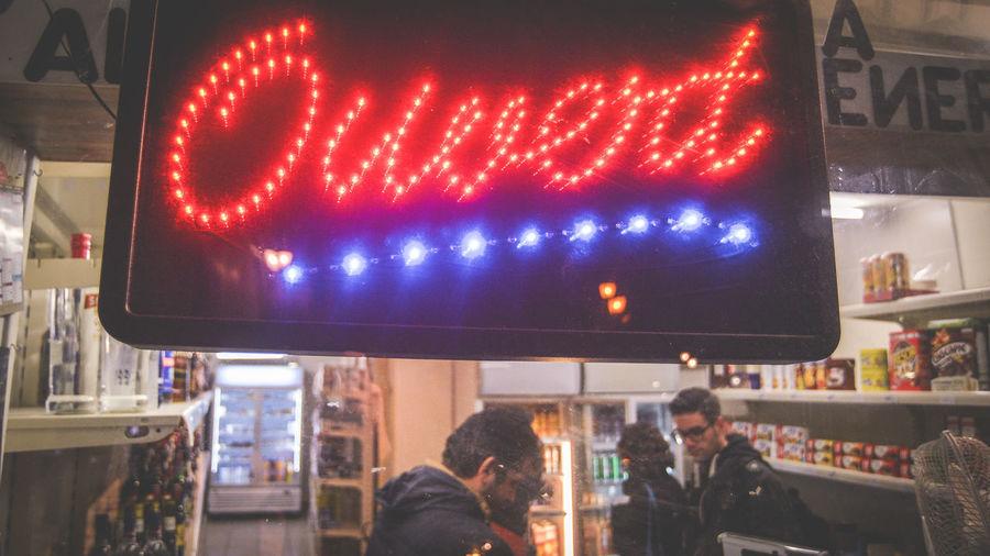 People at illuminated store