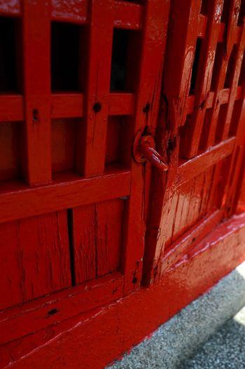 Close-up of red metal door of building