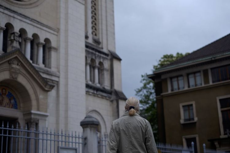 Rear view of man statue against building