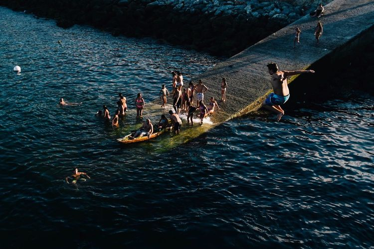 High Angle View Of People Enjoying In Lake