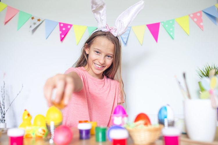 Portrait of girl holding egg