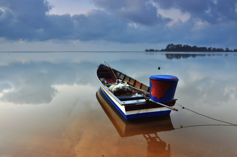 Water Cloud - Sky Sky Nautical Vessel Reflection Nature Tranquility Lake No People Day Moored Mode Of Transportation Tranquil Scene Scenics - Nature Transportation Outdoors Beauty In Nature Waterfront Sinking Rowboat Floating On Water