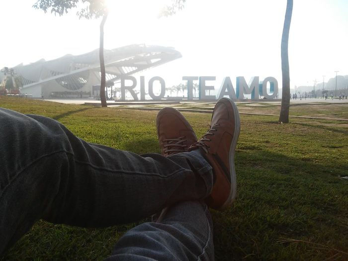 Relaxe quando pode. Personal Perspective Shoe Human Body Part Low Section Human Leg Lying Down One Person Grass Day City Adult Architecture People Sky Only Men Adults Only Indoors  Cityscape Nature One Man Only Museu Do Amanhã