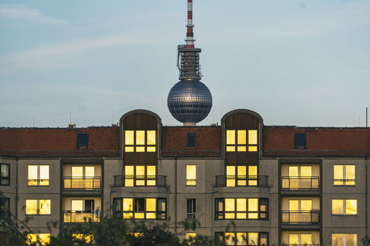 Berlin, Germany, October 08, 2018: Tv Tower Behind Building with Sunset Reflections in Windows Berlin Germany 🇩🇪 Deutschland Horizontal No People Outdoors Color Image Built Structure Architecture Building Exterior Building Sky City Window Tower Office Building Exterior Spire  TV Tower Fernsehturm Television Tower Communications Tower Residential Building Reflection Sunset Façade Mirror